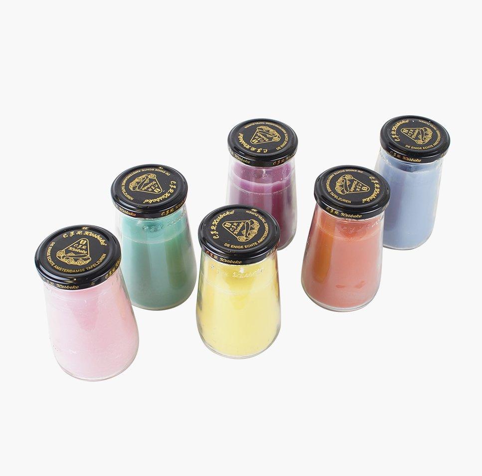 Gekleurde kaarsen in glazen pot Rescued van Studio Perspective