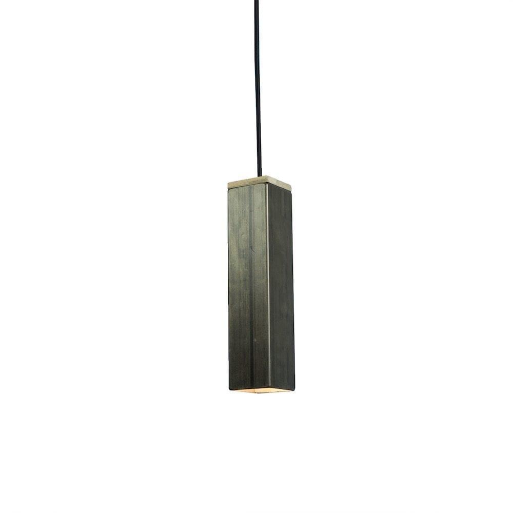Andy Raw van Tolhuijs Design is een duurzame, industriële hanglamp van metaal gemaakt van afval.