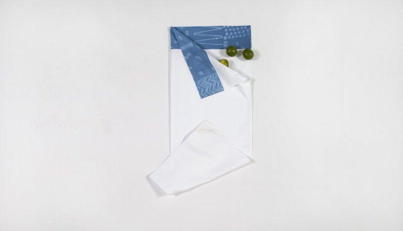 Wit babylakentje met print bij Studio Perspective
