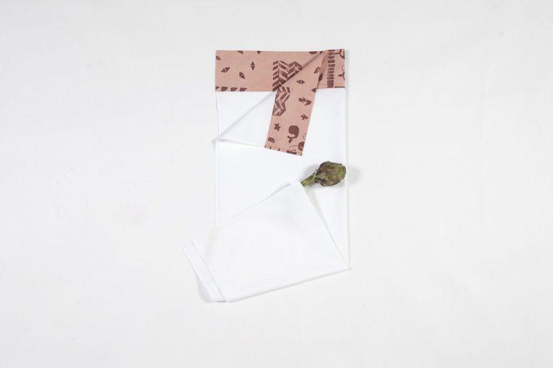 Wit lakentje met roze voor babywieg bij Studio Perspective