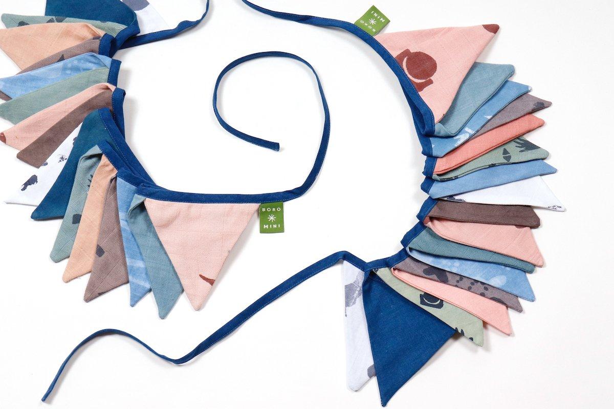 Stoffen vlaggetjes voor kinderkamer bij Studio Perspective