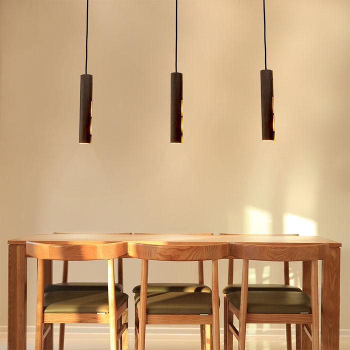 Drie pendellampen eettafel design verlichting